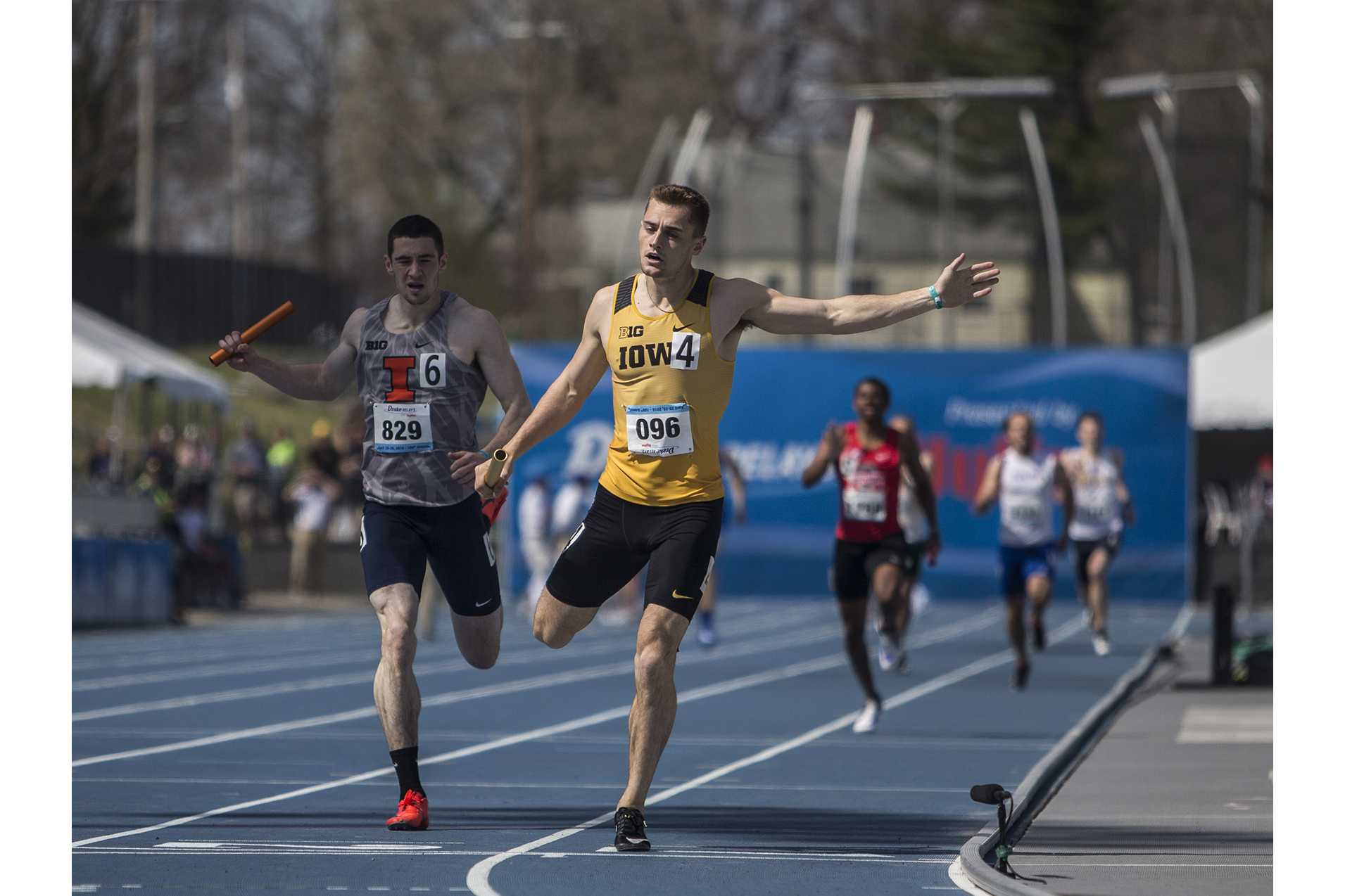 Iowa's Collin Hofacker finishes the final stretch of the mens' 4x400 meter relay during the 2018 Drake Relays at Drake Stadium in Des Moines, Iowa on Friday, April 27, 2018. Iowa placed first in the event with a time of 3:08.67. (Ben Allan Smith/The Daily Iowan)