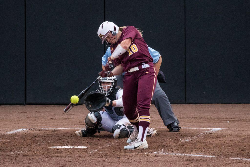 University+of+Minnesota+softball+player+Alex+Velazquez+makes+contact+with+the+ball+during+a+game+against+the+University+of+Iowa+on+Thursday%2C+Apr.+12%2C+2018.+The+Gophers+defeated+the+Hawkeyes+8-0.+%28David+Harmantas%2FThe+Daily+Iowan%29
