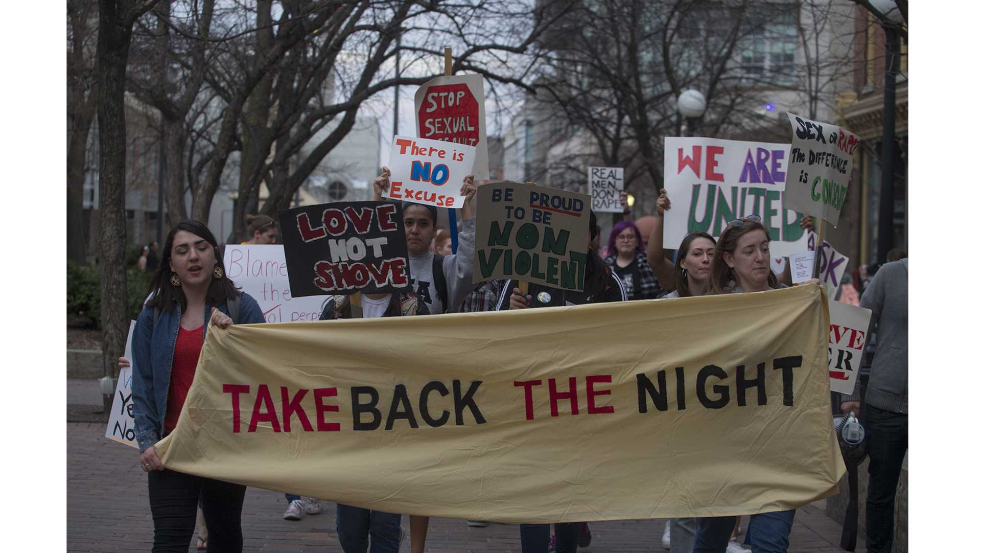 Students march through the Ped Mall during the Take Back the Night Rally on the Pentacrest on Tuesday, Apr. 24, 2018. Various sexual assault support organizations, including WRAC and Monsoon, came together to protest the prevalence of sexual assault in colleges. (Katie Goodale/The Daily Iowan)