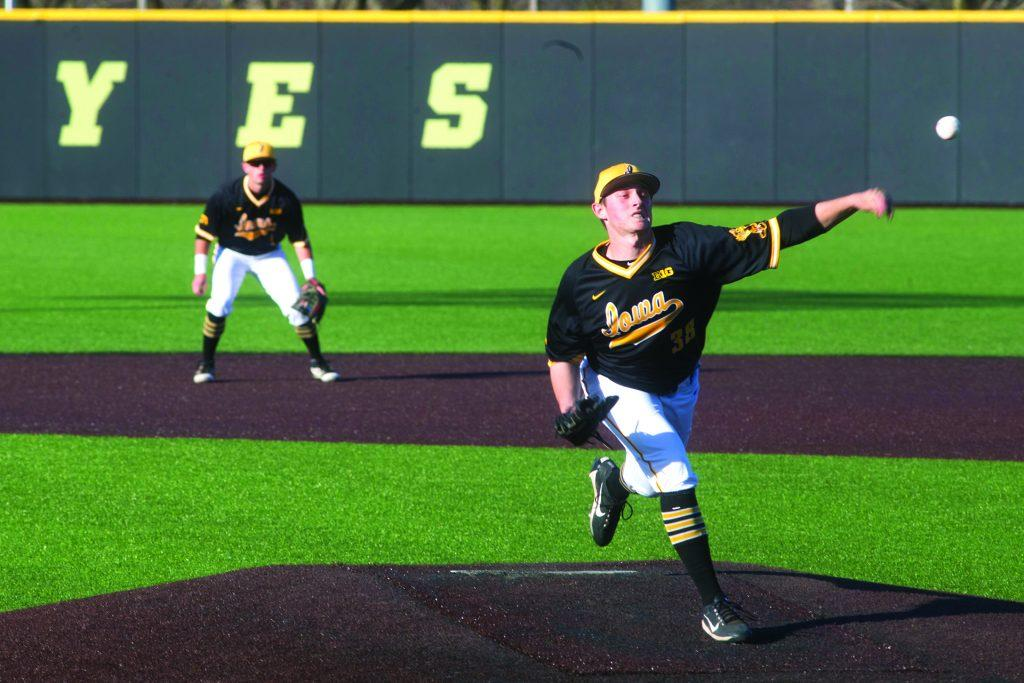 Hawkeye+pitcher%2Foutfielder%2C+Freshman+Trenton+Wallace%2C+warms+up+during+Men%27s+Baseball+at+Duane+Banks+Fields+on+Wednesday+Apr.+25%2C+2018.+The+Hawkeyes+defeated+the+Panthers+12-4.+%28Katie+Goodale%2FThe+Daily+Iowan%29