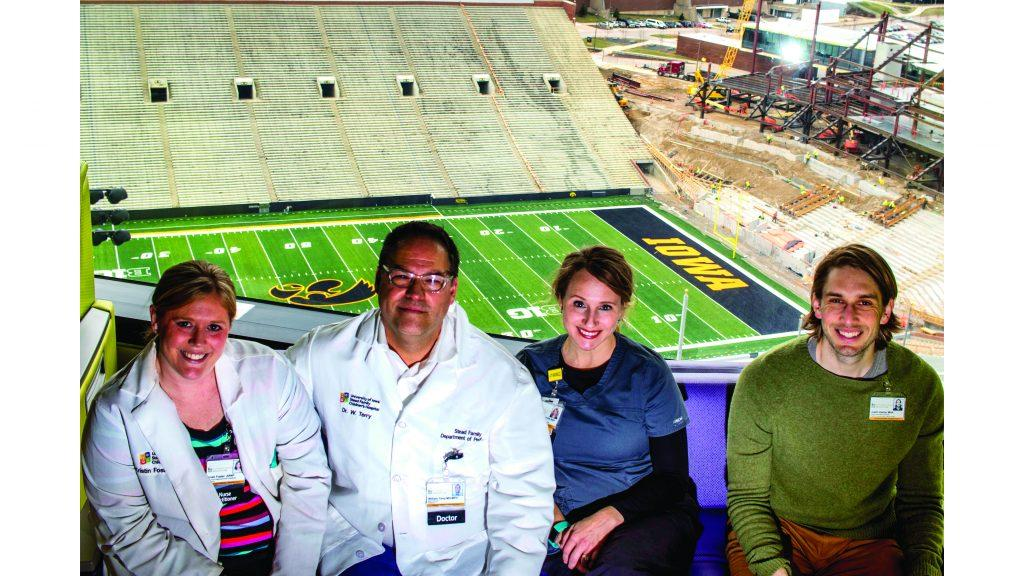 Kristi Foster, Dr. Bill Terry, Lindsey Clifford, and Justin Kahler pose for a portrait inside the Stead Family Children's Hospital on Monday, April 16, 2018. In 2015, UIHC began development of a comprehensive and collaborative AYA Cancer Program bridging the services of the Stead Family Children's Hospital and the Holden Comprehensive Cancer Center. (Lily Smith/The Daily Iowan)