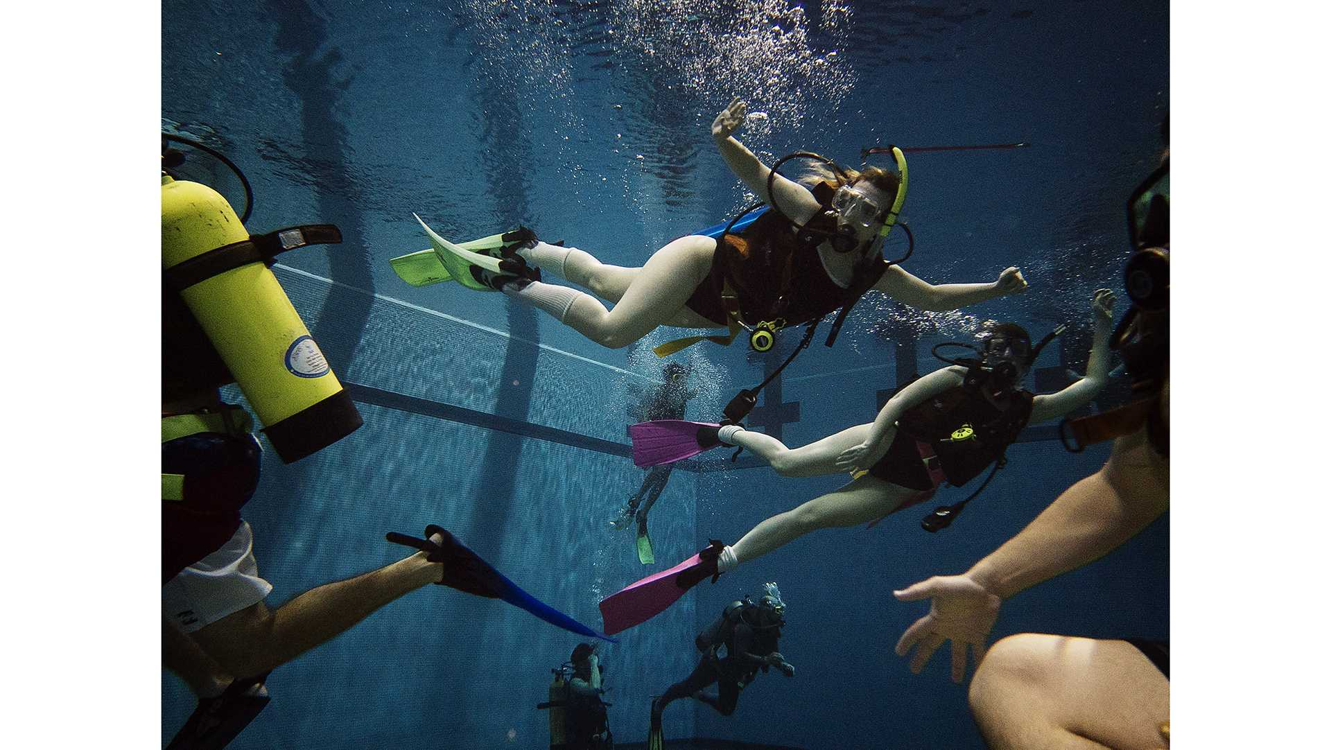 Students enjoy a period of free swimming at the CRWC on Tuesday, April 24, 2018. This was one of the class' last practice sessions before their open water certification at Lake Pearl, Illinois this summer. (James Year/The Daily Iowan)