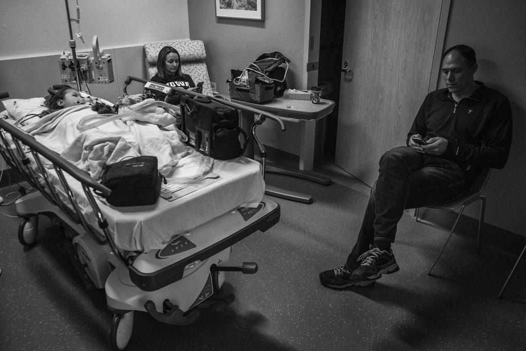 Stellas parents Sarah and Travis wait for Stella to wake up after a successful administration of Spinraza at the Stead Family Childrens Hospital in Iowa City. (Ben Allan Smith/The Daily Iowan)