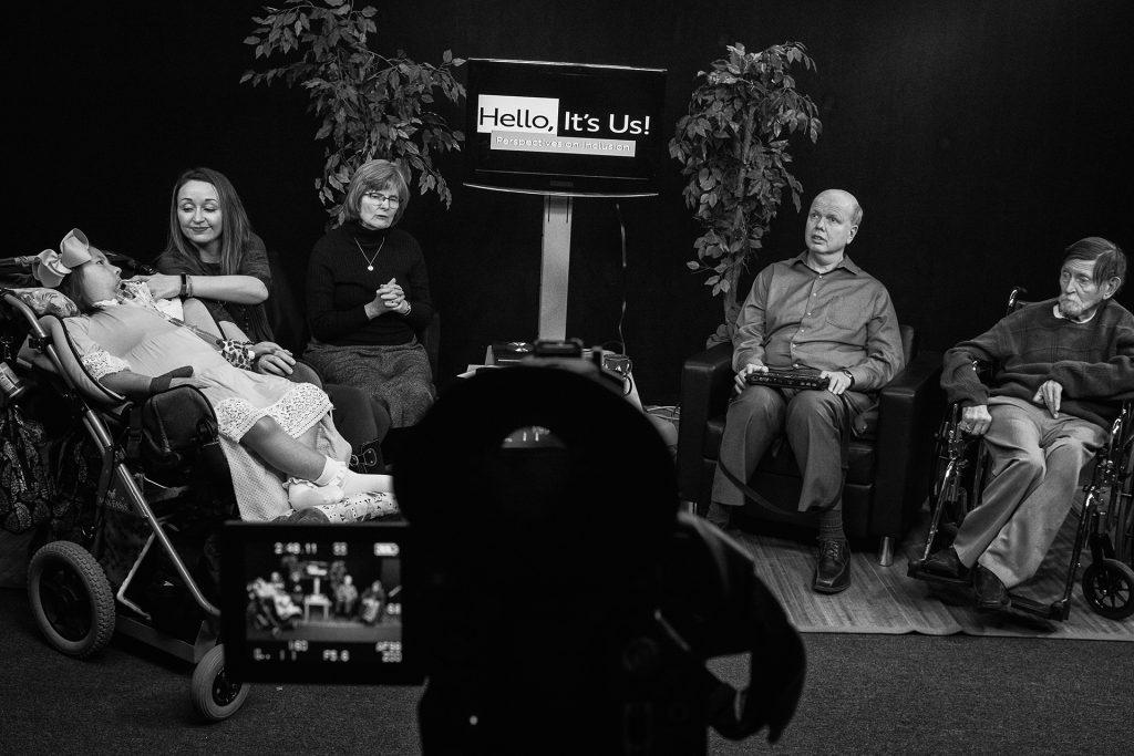 From left: Stella Turnbull, Sarah Turnbull, Chalene Sauer, Mike Hoenig, and Keith Ruff discuss issues relating to disabilities on PATVs show Hello, Its Us at PATVs Iowa City studio. (Ben Allan Smith/The Daily Iowan)