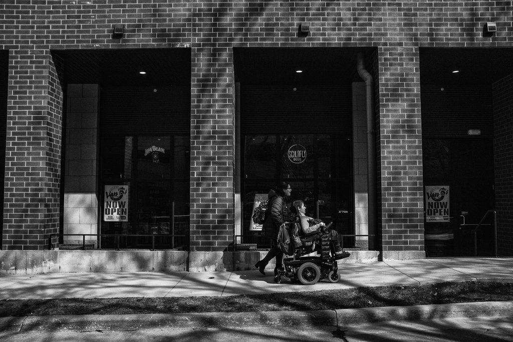 Hannah rides to her apartment in Iowa City after getting coffee with one of her many helpers, Maritza Lopez. (Ben Allan Smith/The Daily Iowan)