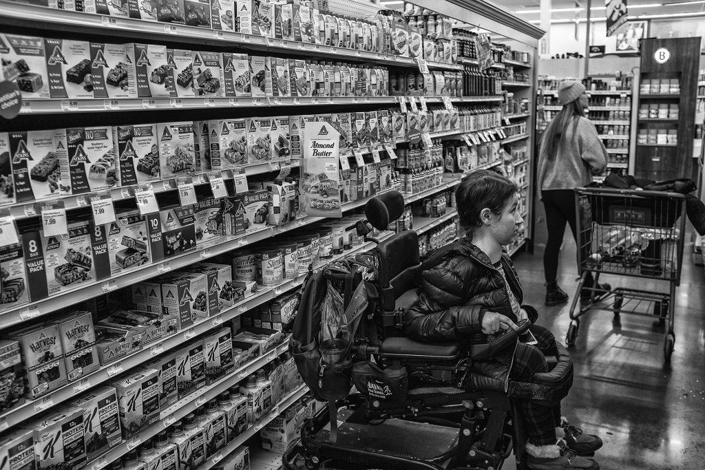 Hannah strolls through the aisles of Hy-Vee in Iowa City to look for cooking supplies. (Ben Allan Smith/The Daily Iowan)