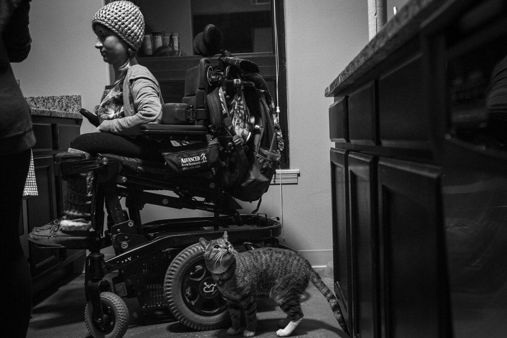 Hannah and her cat Mercury wait in the kitchen of her Iowa City apartment. (Ben Allan Smith/The Daily Iowan)