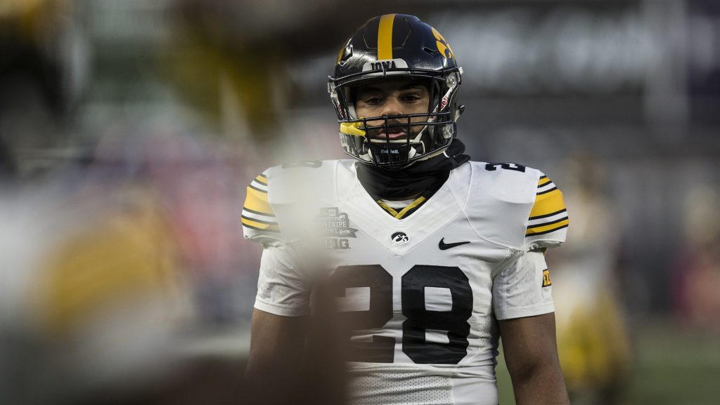 Iowa%27s+Toren+Young+%2828%29+warms+up+before+kickoff+of+the+New+Era+Pinstripe+Bowl+at+Yankee+Stadium+in+New+York+on+Wednesday%2C+Dec.+27.+%28Ben+Allan+Smith%2FThe+Daily+Iowan%29
