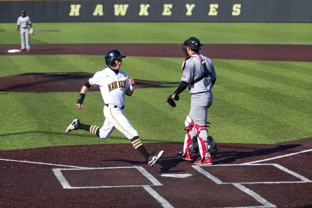 Tyler+Cropley+scores+a+run+during+Iowa+baseball+vs.+Northern+Illinois+at+Banks+Field+on+April+17%2C+2018.+The+Hawkeyes+won+the+game+2-0.+%28Megan+Nagorzanski%2FThe+Daily+Iowan%29