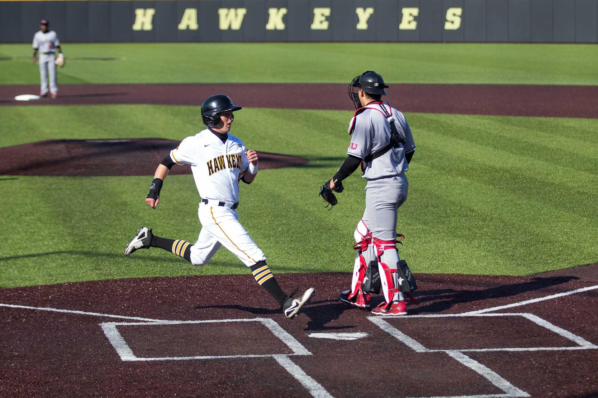 Tyler Cropley scores a run during Iowa baseball vs. Northern Illinois at Banks Field on April 17, 2018. The Hawkeyes won the game 2-0. (Megan Nagorzanski/The Daily Iowan)