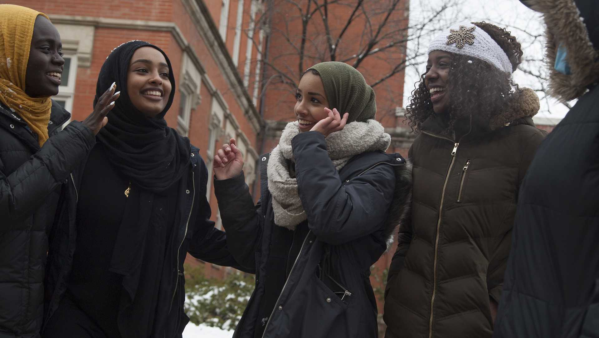 Members of the UI Muslim Student Association: sophomore Tartil Ali, freshman Ebteehal Kmail, sophomore Seeme Kotoh, sophomore Amani Ali, junior Ayah Taha, junior Taimaa Shoukih, and sophomore Suha Suleman throw snowball after passing out flowers for Islam appreciation week on the T. Anne Cleary Walkway on April 9, 2018.