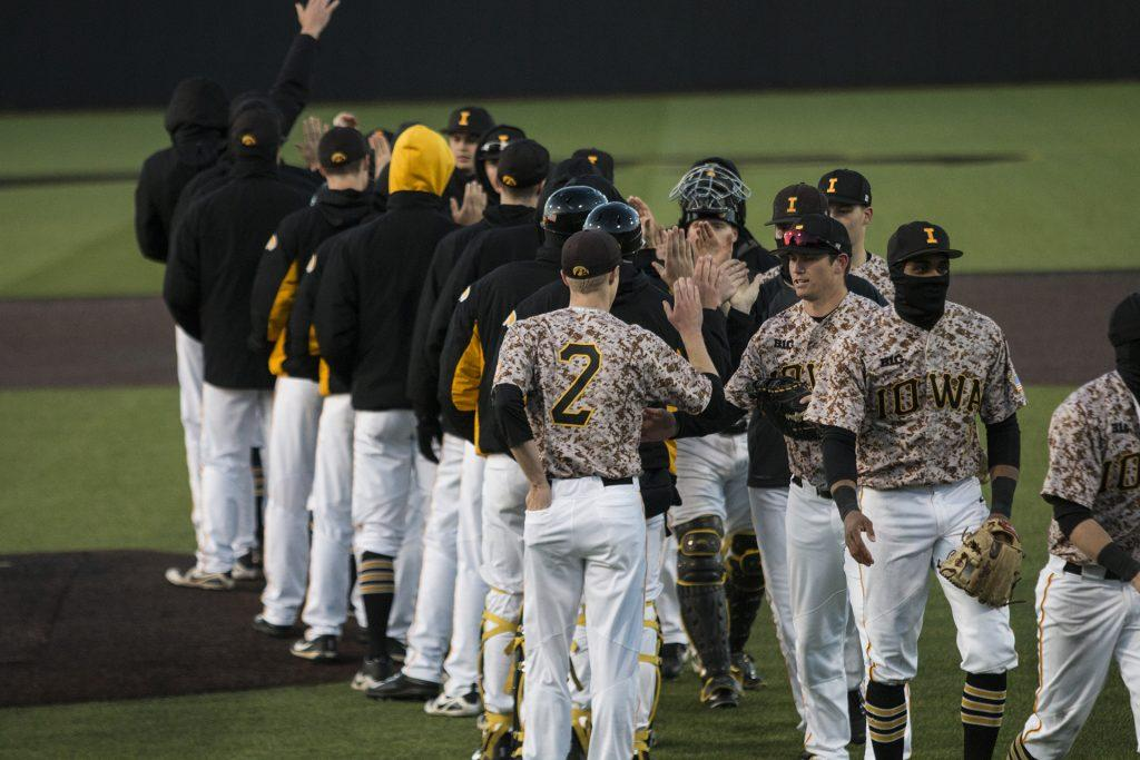Iowa+players+congratulate+each+other+during+men%27s+baseball+Iowa+vs.+OSU+at+Duane+Banks+Field+on+April+7%2C+2018.+The+Hawkeyes+defeated+the+Buckeyes+9-5.+%28Katina+Zentz%2FThe+Daily+Iowan%29