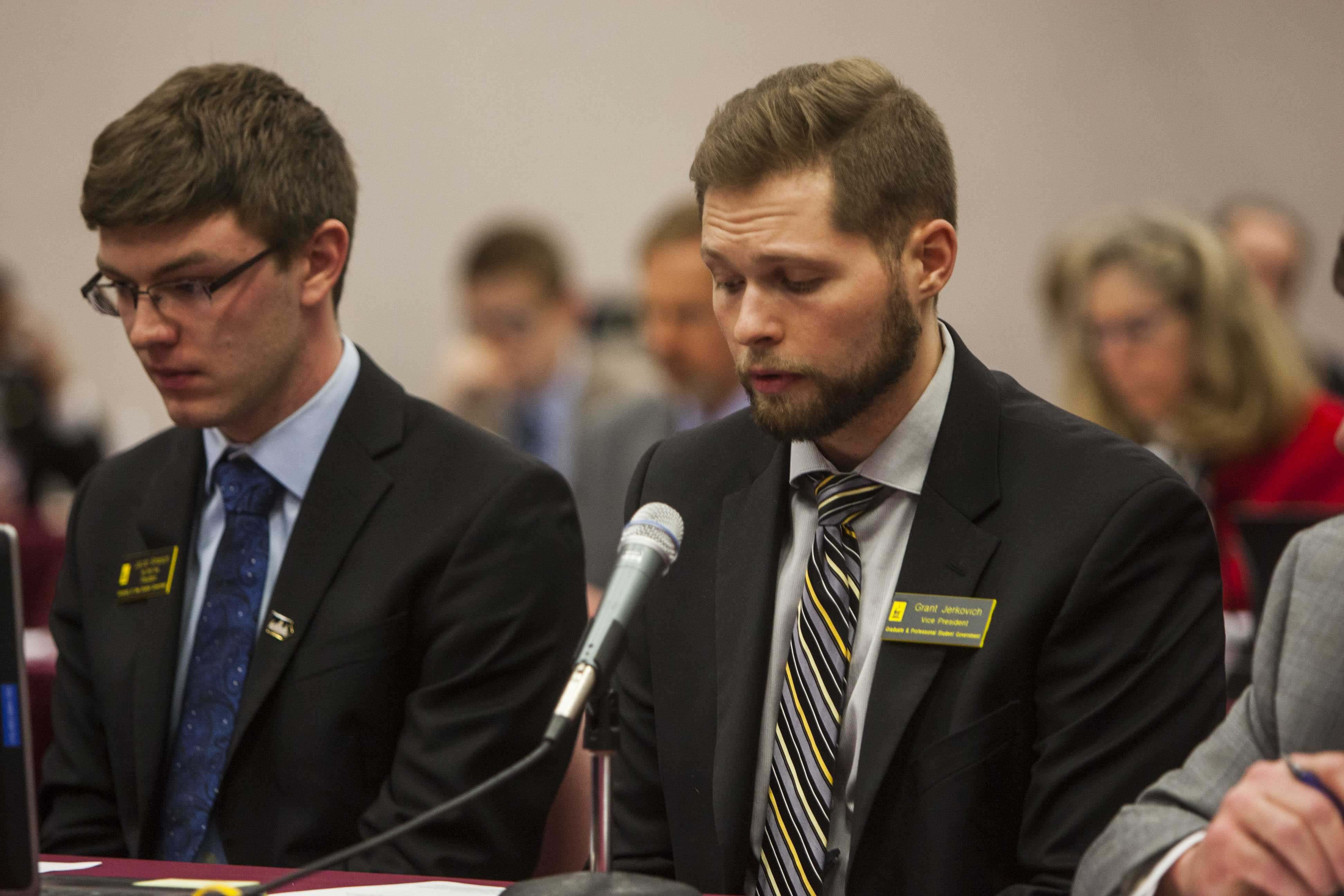 UISG President Jacob Simpson and GPSG Vice President Grant Jerkovich speak to the state Board of Regents about the effect of tuition increases on the student body on Thursday, April 12, 2018 at the Iowa School for the Deaf in Council Bluffs. (Emily Wangen/The Daily Iowan)