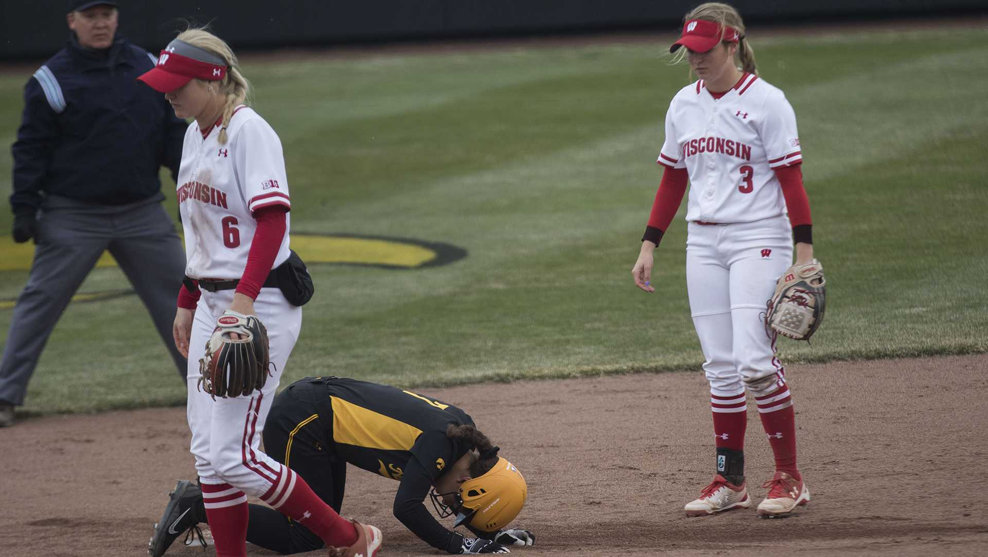 Iowa's Lea Thompson kneels next to the base during the Iowa/Wisconsin softball game at Bob Pearl Field  on Sunday, April 8, 2018. The Hawkeyes defeated the Badgers in the third game of the series, 5-3. (Lily Smith/The Daily Iowan)