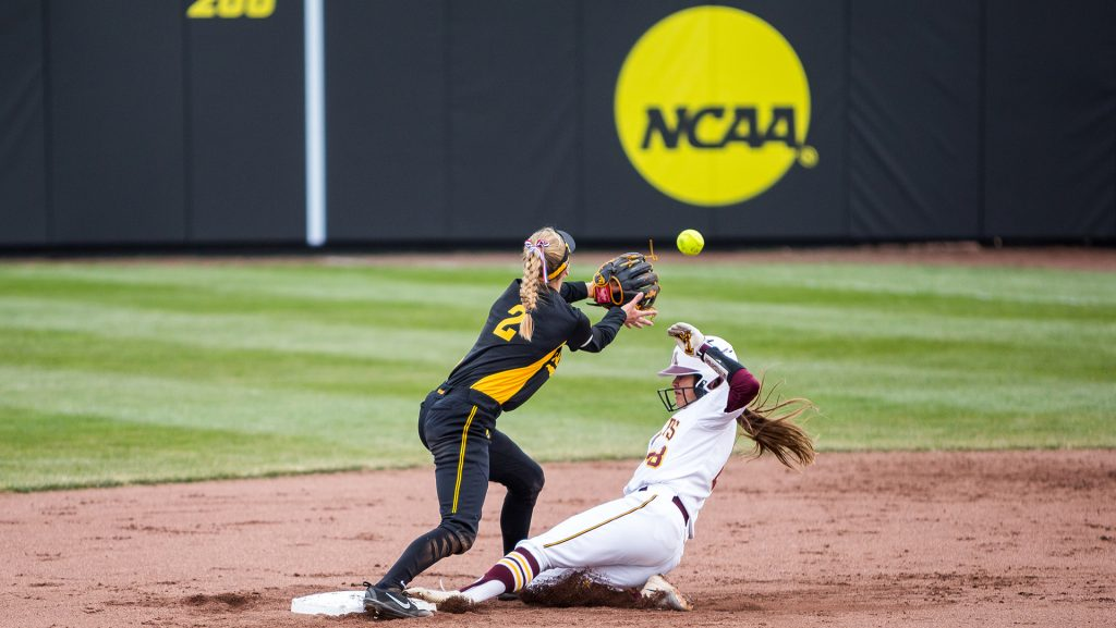 University+of+Iowa+softball+player+Aralee+Bogar+waits+for+the+ball+as+a+Minnesota+player+slides+to+safety+during+a+game+against+the+University+of+Minnesota+on+Friday%2C+Apr.+13%2C+2018.+The+Gophers+defeated+the+Hawkeyes+6-2.+%28David+Harmantas%2FThe+Daily+Iowan%29