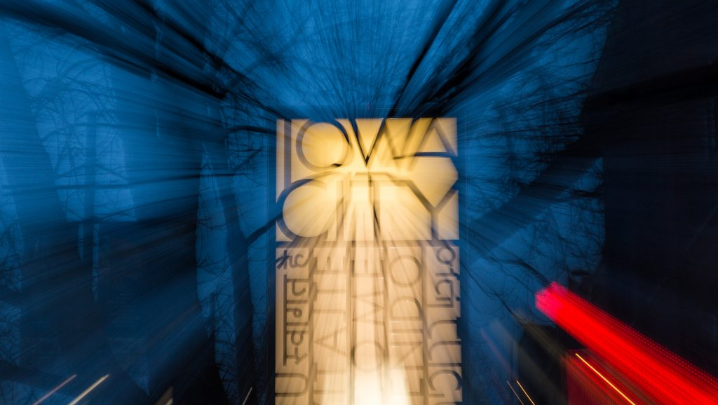 Signs+in+downtown+Iowa+City+pay+homage+to+its+status+as+a+UNESCO+City+of+Literature.+Iowa+City+is+the+host+for+the+2018+annual+meeting+of+the+UNESCO+Cities+of+Literature.+Apr.+2%2C+2018+%28David+Harmantas%2FThe+Daily+Iowan%29