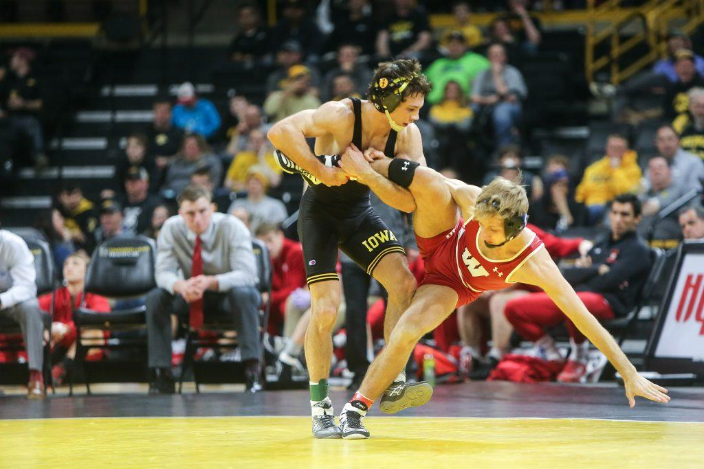 Iowas Thomas Gilman tires to takedwon Wisconsins Jens Lantz during the Iowa v. Wisconsin wrestling bout, in Carver-Hawkeye  in Iowa City, Iowa  on Friday, Feb. 3, 2017. The Hawkeyes defeated the Badgers with a team overall of 33-8. (The Daily Iowan/Anthony Vazquez)