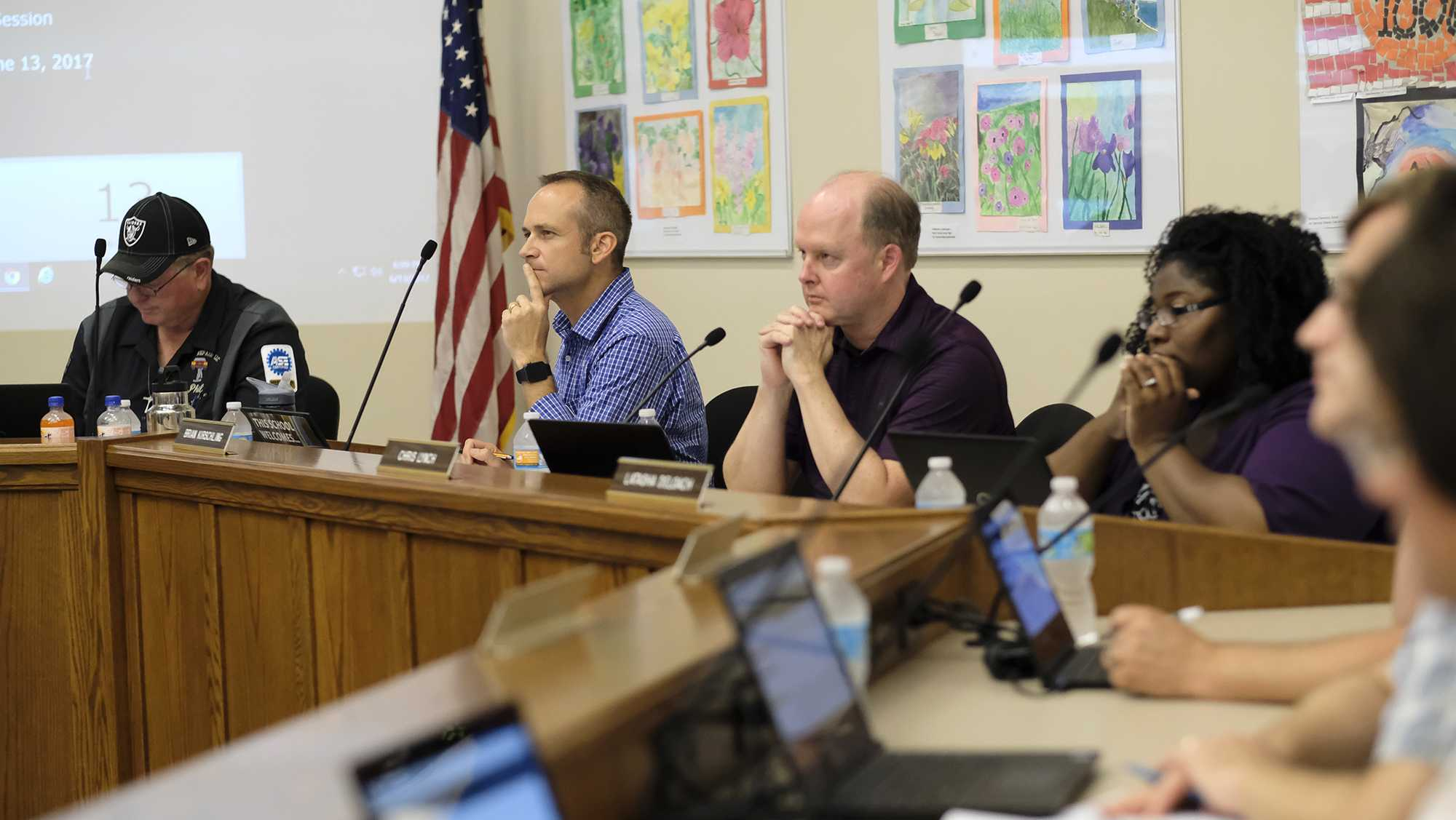 Members of the board listen as a member of the public adresses the Iowa City School Board on Tuesday June 13, 2017. (The Daily Iowan/Nick Rohlman)
