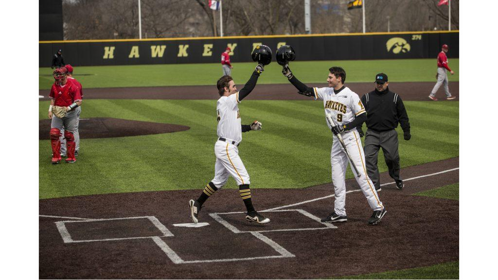 Iowa%27s+Justin+Jenkins+crosses+home+plate+after+hitting+a+home+run+during+Iowa%E2%80%99s+doubleheader+against+number+11+ranked+Indiana+at+Duane+Banks+Field+on+Friday+March+23%2C+2018.+The+Hoosiers+won+the+first+game+4-2+and+the+Hawkeyes+won+the+second+game+5-1.+%28Nick+Rohlman%2FThe+Daily+Iowan%29