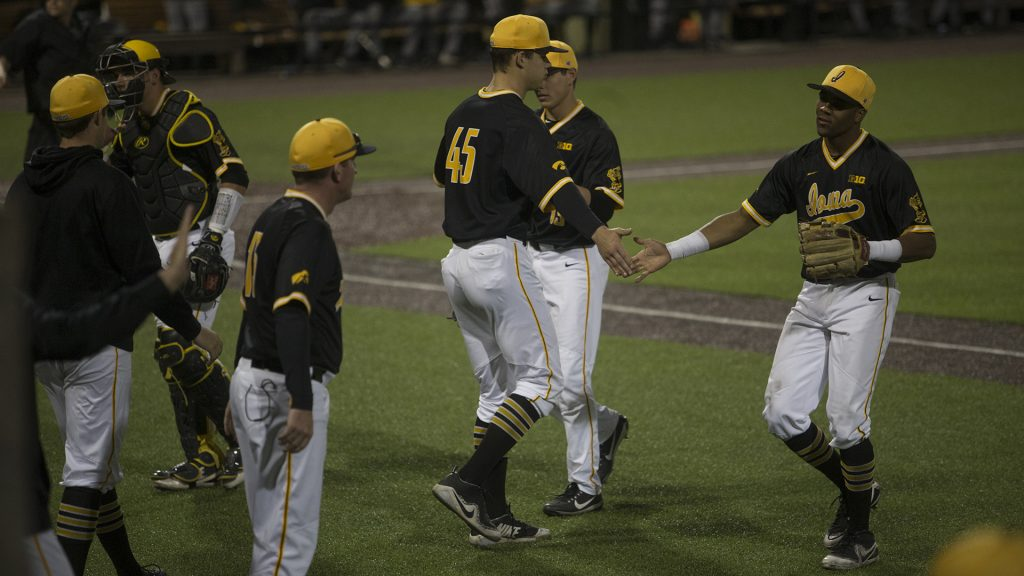 Hawkeyes+sophomore+Lorenzo+Elion+and+sophomore+Kyle+Shimp+high-five+between+innings+during+Men%27s+Baseball+at+Duane+Banks+Fields+on+Wednesday+Apr.+25%2C+2018.+The+Hawkeyes+defeated+the+Panthers+12-4.+%28Katie+Goodale%2FThe+Daily+Iowan%29