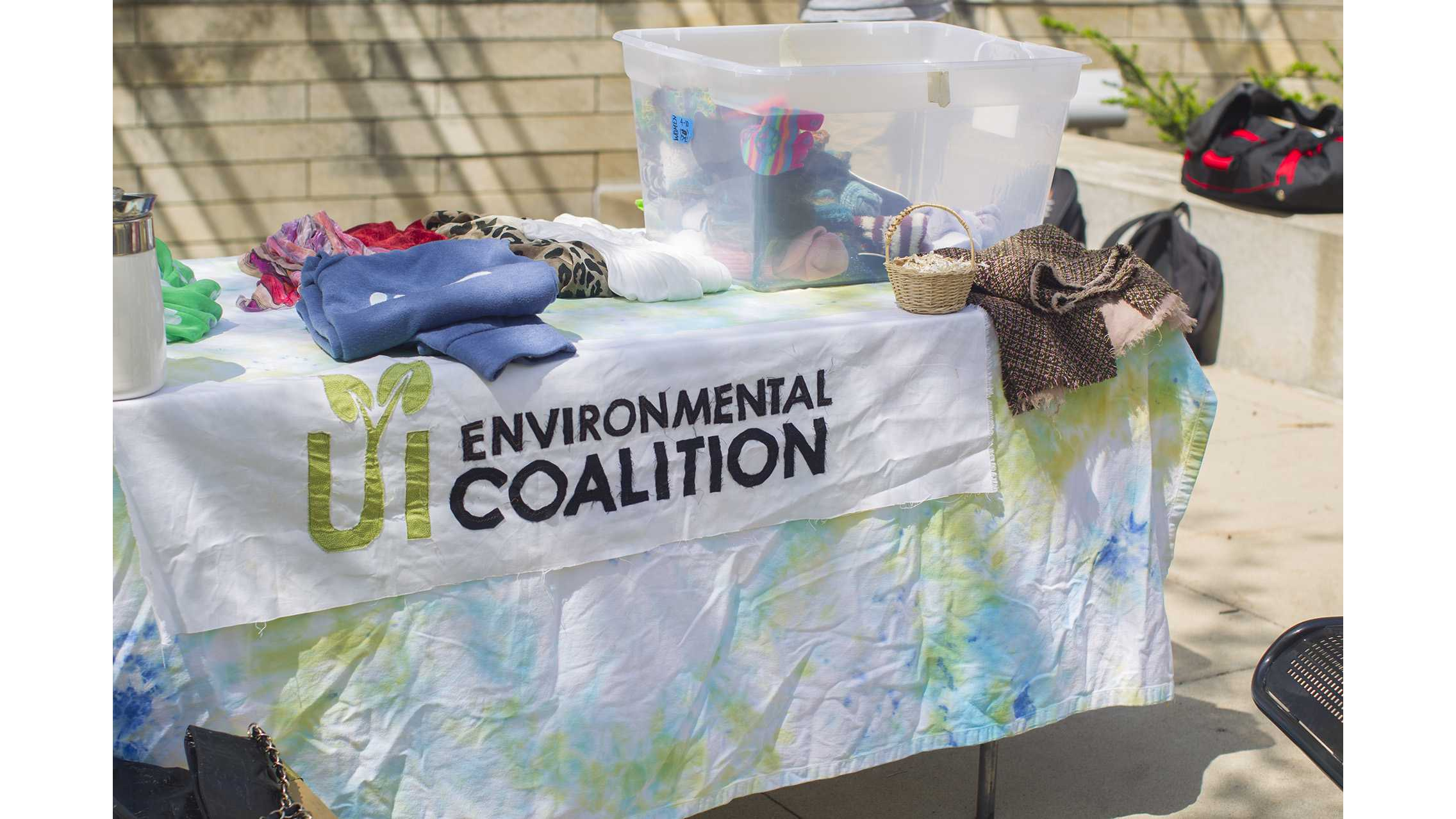 UI Environmental Coalition's logo is shown on a table during the UI Environmental Coalition's Treasure Trade on the T. Anne Cleary Walkway on Tuesday, April 25, 2017. (Lily Smith/The Daily Iowan)