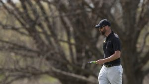 Iowa head coach Tyler Stith walks on the green during the Hawkeye Invitational at Finkbine Golf Course on Sunday, April 16, 2017. The Hawkeyes finished second, behind Texas Tech, in the tournament after three rounds scoring 859 (-5; 289, 285, 285).