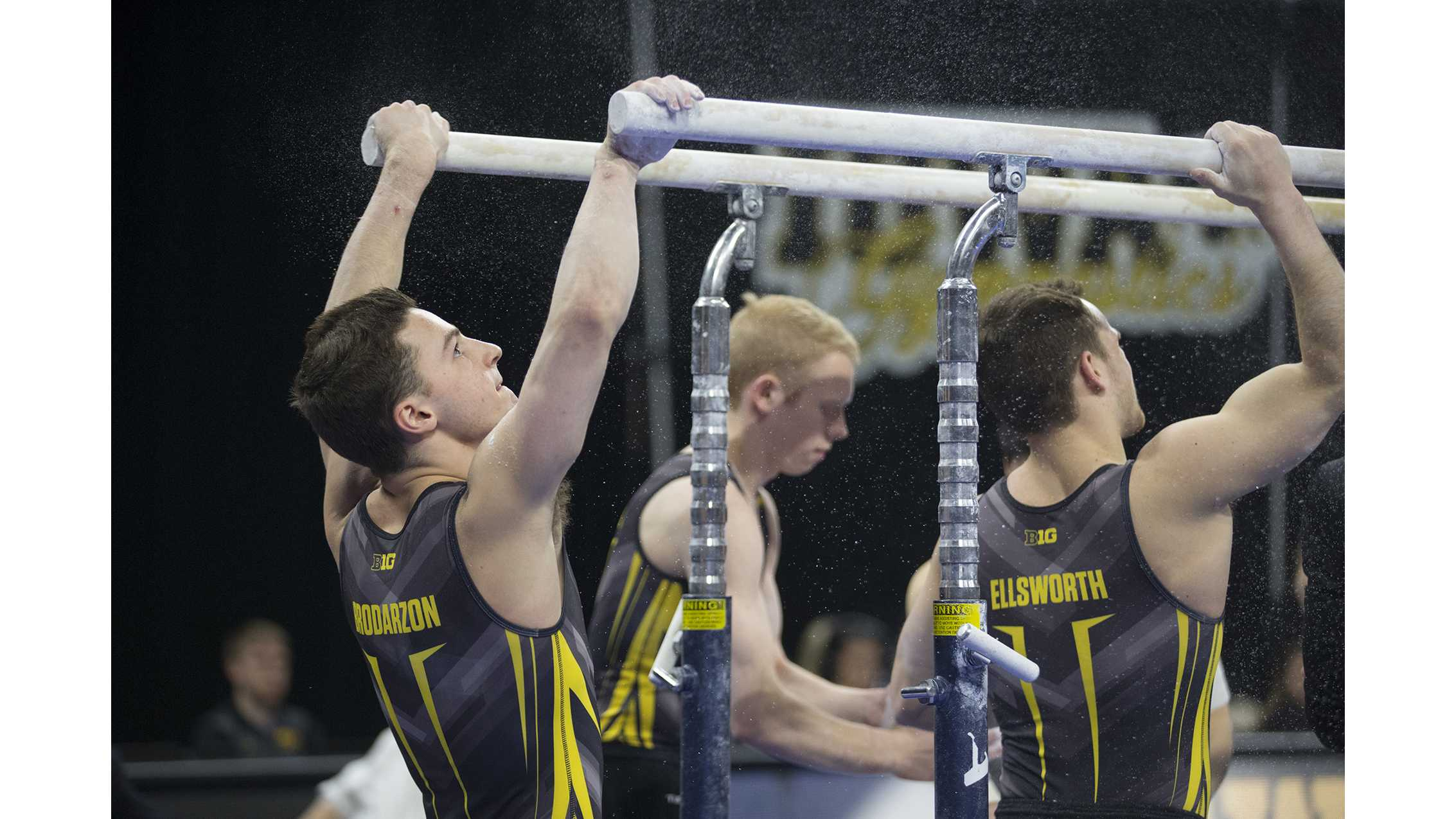 Hawkeye members Jake Brodarzon, Nick Merryman, and Dylan Ellsworth put chalk on the parallel bars before they compete during men's gymnastics Iowa vs. Penn State and Arizona State on March 3, 2018 at Carver Hawkeye Arena.