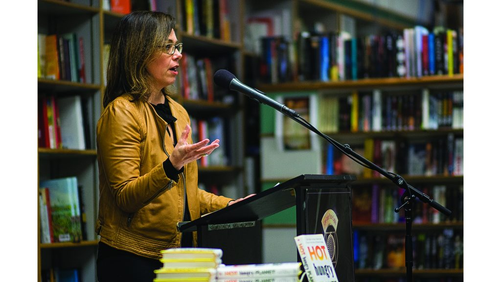 Author Lisa Palmer reads her book Hot Hungry Planet: The Fight to Stop the Global Food Crisis at Prairie Lights on Tuesday, Apr. 3, 2018. (James Year/The Daily Iowan)