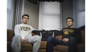 Sebastian (left) and David (right) Jackowski sit inside the living room of David's house on Linn Street on Monday, April 16. Their brother Kamil died last year at an out-of-state formal for his fraternity. April 30 marks the one-year anniversary of his death.