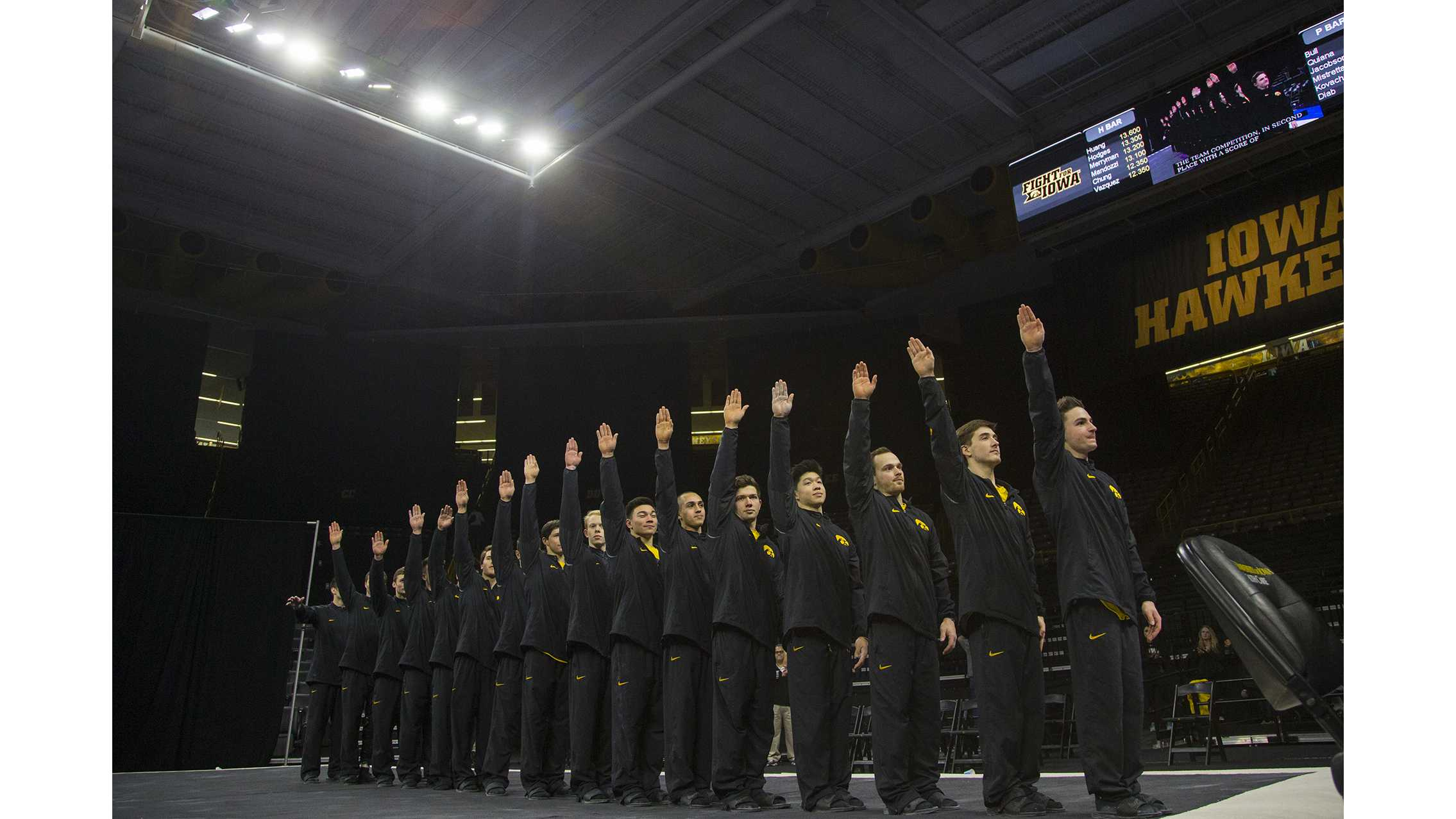 during the Iowa/Illinois men's gymnastics meet at Carver-Hawkeye Arena on Saturday, Feb. 3, 2018. The Fighting Illini defeated the Hawkeyes, 404.700-401.850, to lose their home opener. (Lily Smith/The Daily Iowan)
