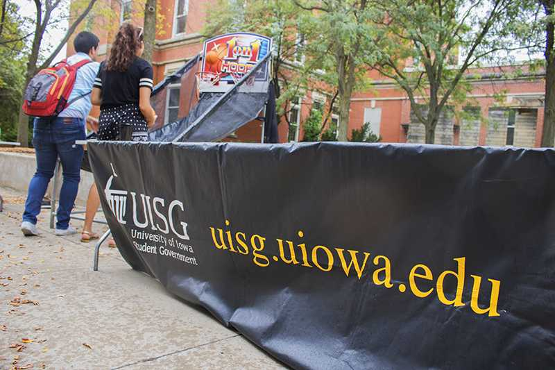 Students shoot hoops on the T. Anne Cleary Walkway on Tuesday, September 26, 2017. UISG hosted tables where students could register to vote.