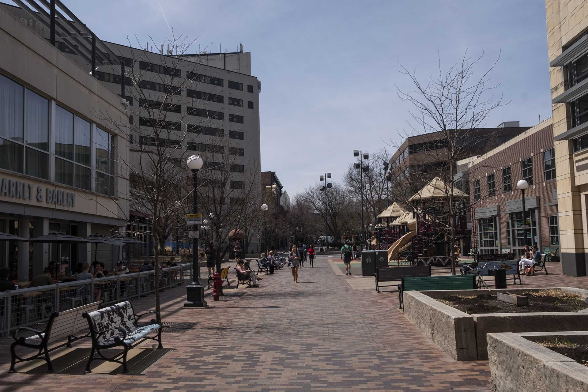 People walk in the Iowa City Pedestrian Mall on Thursday, April 26, 2018. Iowa City has released plans for renovations and updates to the area. (Nick Rohlman/The Daily Iowan)