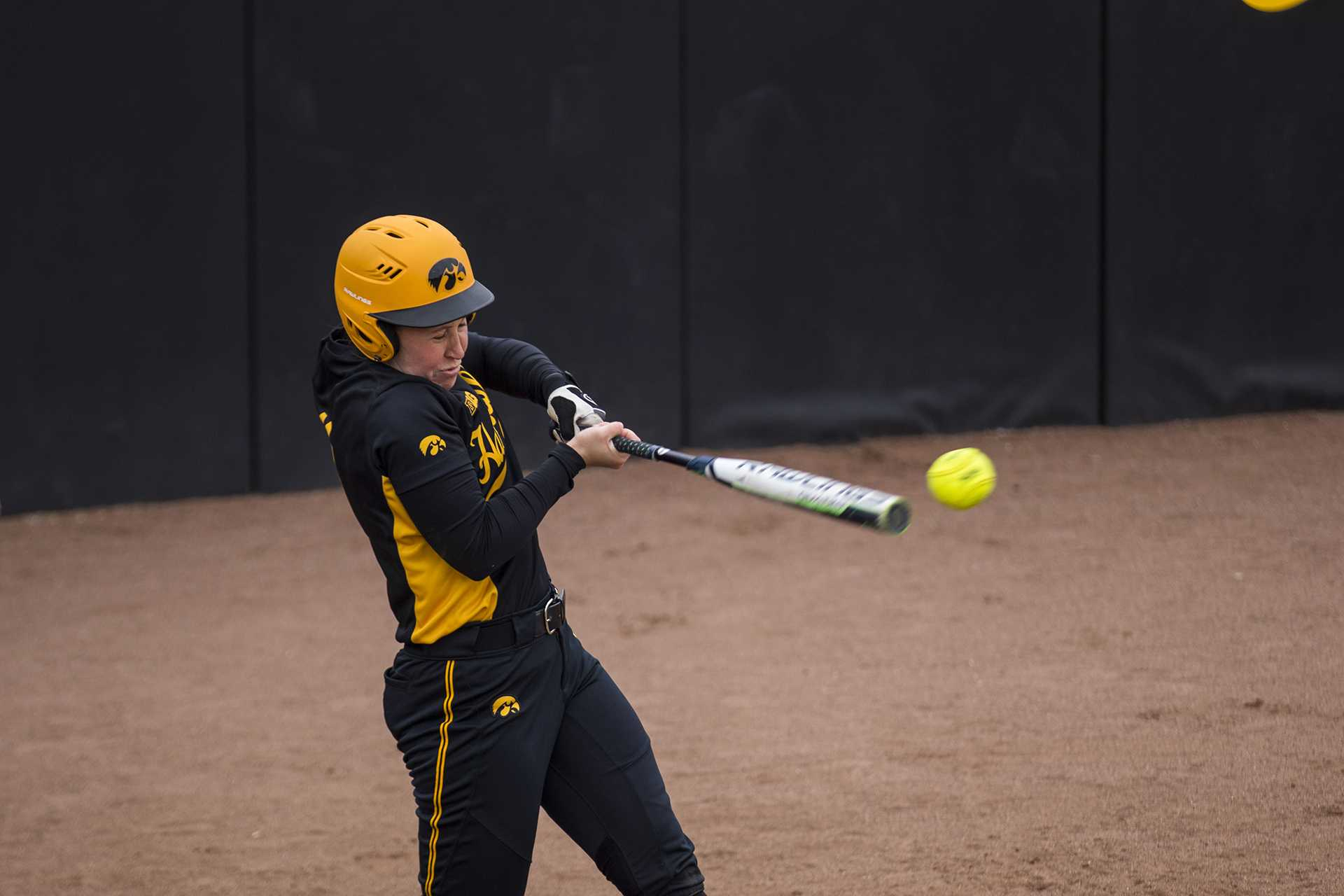 Iowa's Mallory Kilian hits a ball during the Iowa/Wisconsin softball game at Bob Pearl Field  on Sunday, April 8, 2018. The Hawkeyes defeated the Badgers in the third game of the series, 5-3. (Lily Smith/The Daily Iowan)