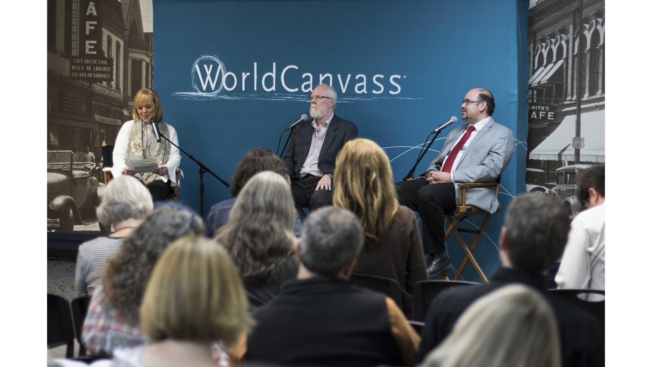 Joan Kjaer (left) interviews professors Greg Carmichael (center) and Gabriele Villarini (right) at MERGE in Iowa City on Wednesday, April 25, 2018. (Shivansh Ahuja/The Daily Iowan)