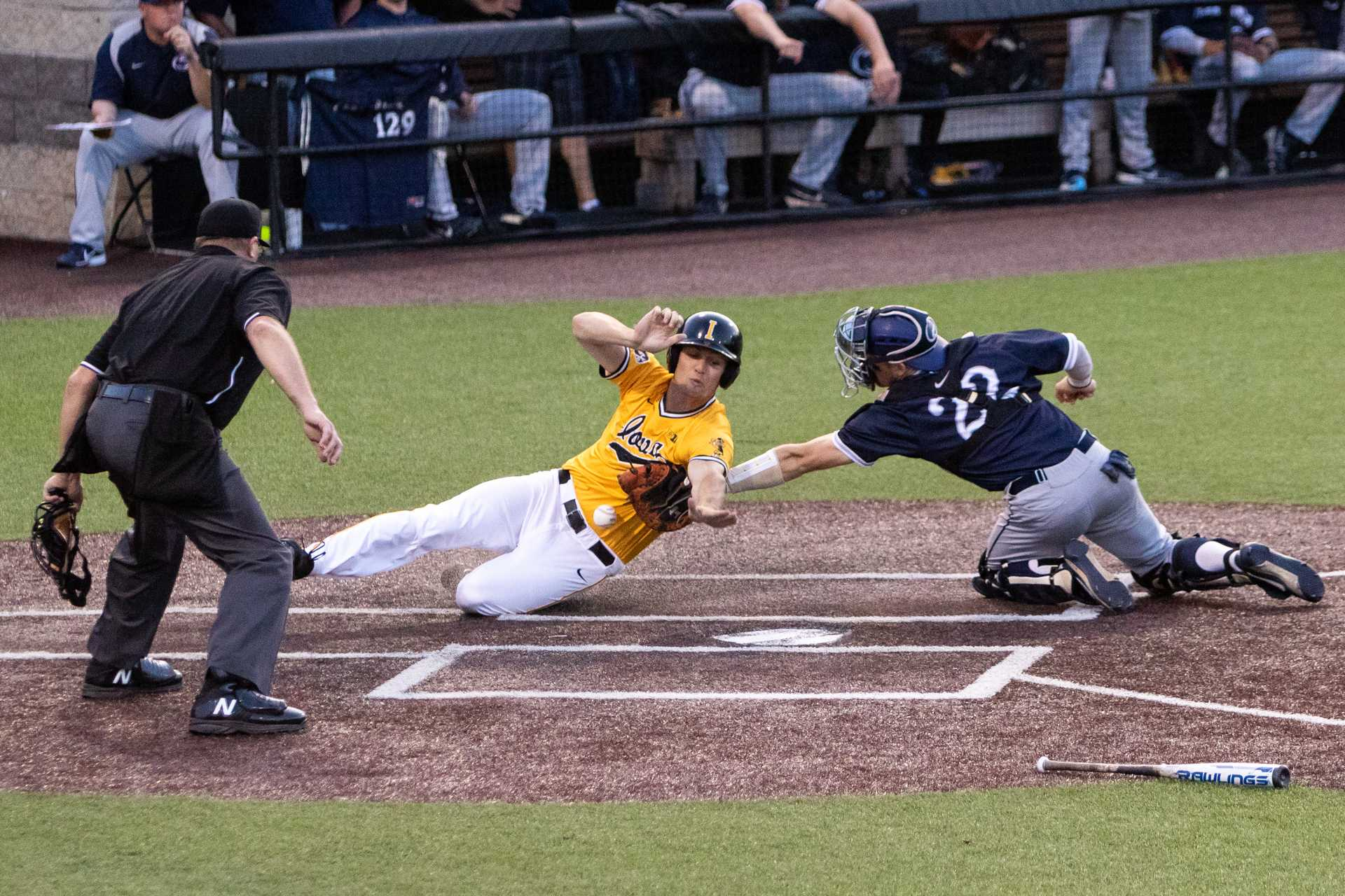 University of Iowa baseball player Kace Massner slides into home during a game against Penn State University on Saturday, May 19, 2018. The catcher dropped the ball allowing the runner to score and the Hawkeyes defeated the Nittany Lions 8-4. (David Harmantas/The Daily Iowan)
