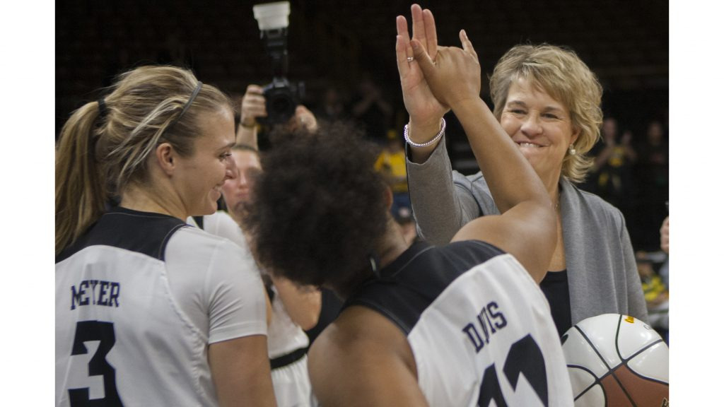 Iowa+head+coach+Lisa+Bluder+high+fives+guard+Tania+Davis+during+the+Iowa%2FQuinnipiac+basketball+game+at+Carver-Hawkeye+Arena+on+Friday%2C+Nov.+10%2C+2017.+The+Hawkeyes+defeated+the+Bobcats%2C+83-67%2C+for+Bluder%27s+700+career+win.+%28Lily+Smith%2FThe+Daily+Iowan%29
