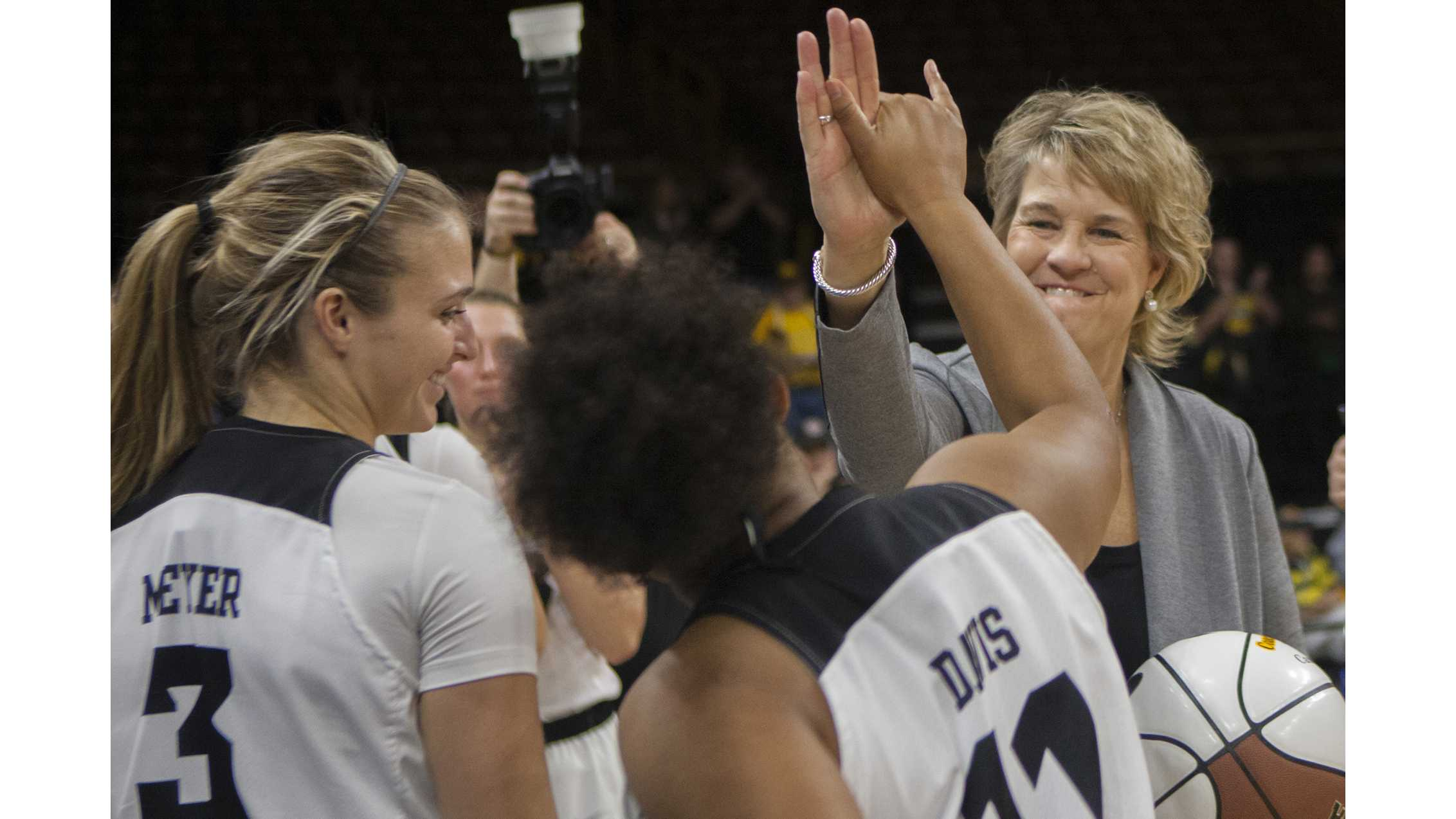 Iowa head coach Lisa Bluder high fives guard Tania Davis during the Iowa/Quinnipiac basketball game at Carver-Hawkeye Arena on Friday, Nov. 10, 2017. The Hawkeyes defeated the Bobcats, 83-67, for Bluder's 700 career win. (Lily Smith/The Daily Iowan)