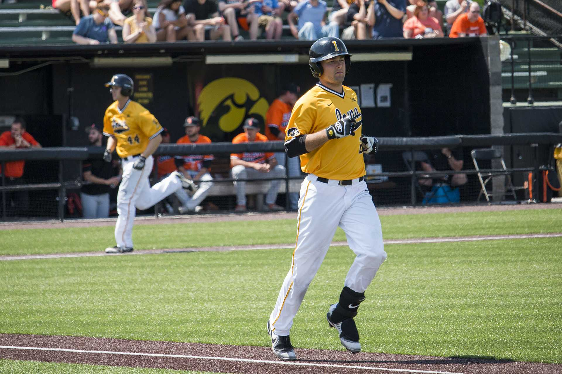 Iowa infielder Kyle Crowl runs to first base during baseball Iowa vs. Oklahoma State at Duane Banks Field on May 6, 2018. The Hawkeyes defeated the Cowboys 11-3.  (Katina Zentz/The Daily Iowan)