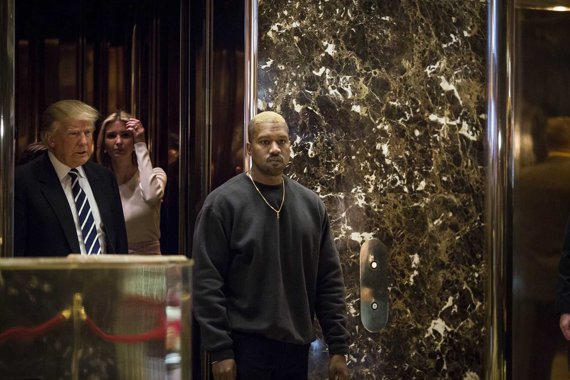 U.S. President-elect Donald J. Trump and Musician Kanye West pose for photographers in the lobby of Trump Tower on Dec. 13, 2016 in Manhattan, New York. (Photo by John Taggart/Sipa USA/TNS)