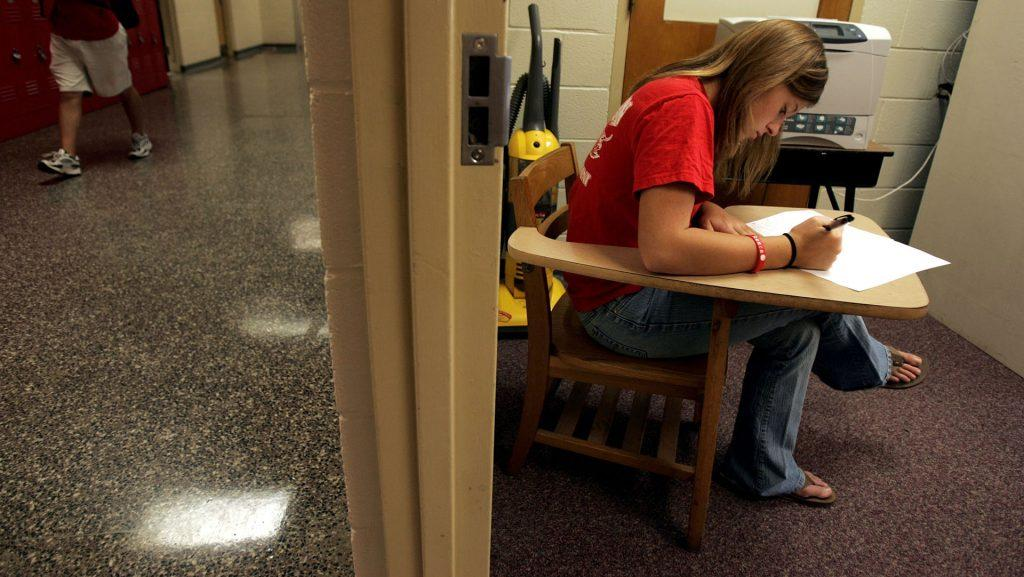 North Johnston High School senior Paula Luper, right, 18, takes a Principles of Business quiz in the teachers lounge so that she can avoid distraction, May 24, 2007, in Micro, North Carolina. Luper, who was diagnosed with ADHD in elementary school, uses this method for focusing while at school. (Juli Leonard/Raleigh News & Observer/MCT)