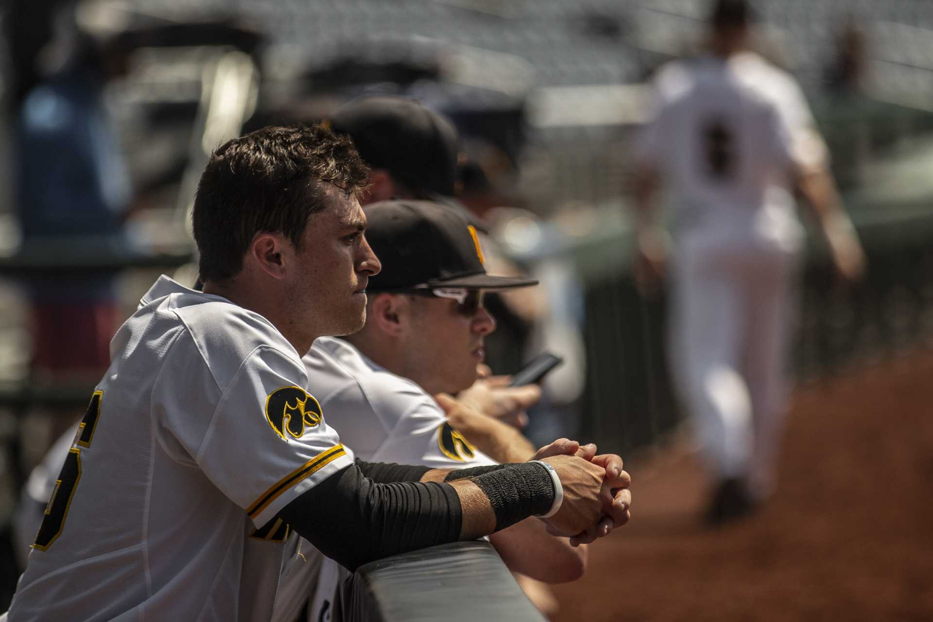 Iowa players lean on the dugout railing after Iowa's Big Ten tournament game against Ohio State on Thursday, May 24, 2018. The Buckeyes defeated the Hawkeyes 2-0. (Nick Rohlman/The Daily Iowan)