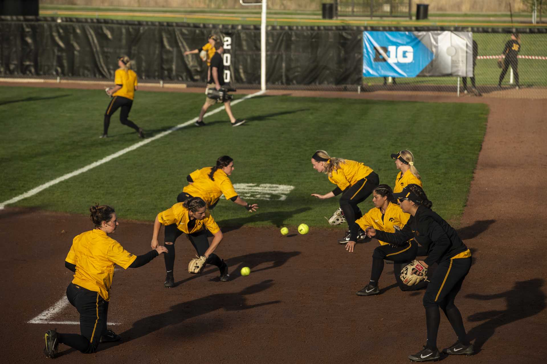 The Iowa softball team warms up before IowaÕs Big Ten tournament game against Ohio State at the Goodman Softball complex in Madison, WI. The Hawkeyes defeated the Buckeyes 5-1. (Nick Rohlman/The Daily Iowan)
