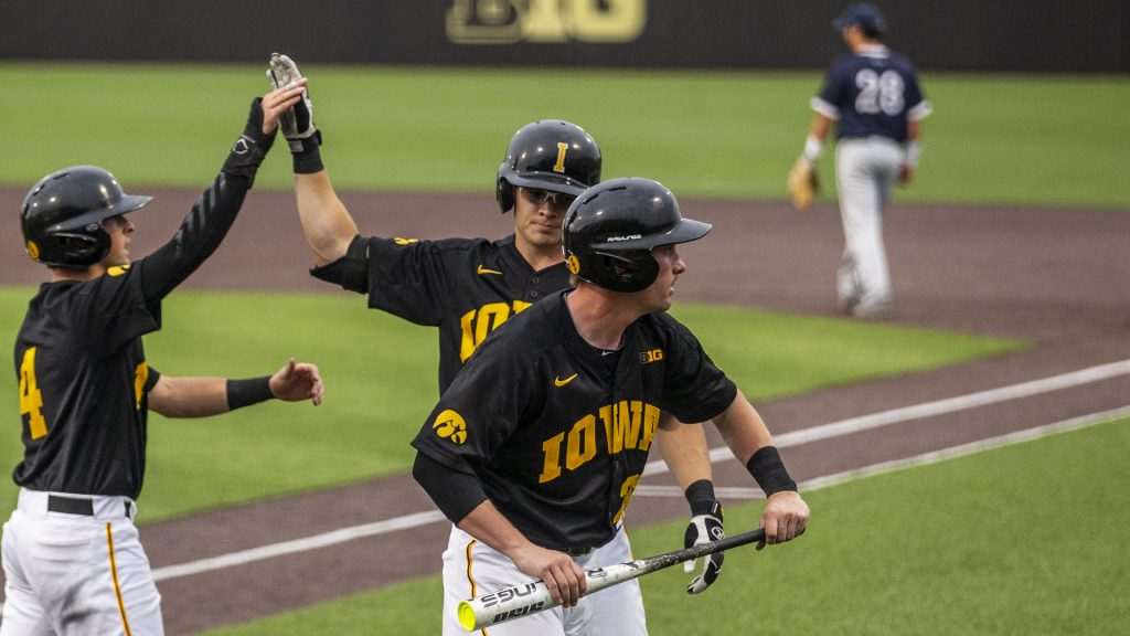 The+Hawkeyes+celebrate+after+scoring+to+take+the+lead+during+their+game+against+Penn+State+at+Duane+Banks+Field+on+Friday+May+18%2C+2018.+The+Hawkeyes+defeated+the+Nitany+Lions+9-1.+%28Nick+Rohlman%2FThe+Daily+Iowan%29