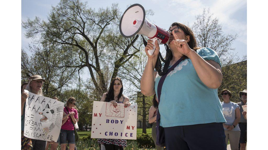 A+woman+speaks+during+a+protest+on+the+Pentacrest+in+Iowa+City+on+Saturday%2C+May+5.+The+protest+was+held+in+response+to+Gov.+Kim+Reynolds%27+signing+of+a+new+bill+that+will+ban+abortions+after+a+heartbeat+is+detected+in+the+early+stages+of+pregnancy.+%28Ben+Allan+Smith%2FThe+Daily+Iowan%29