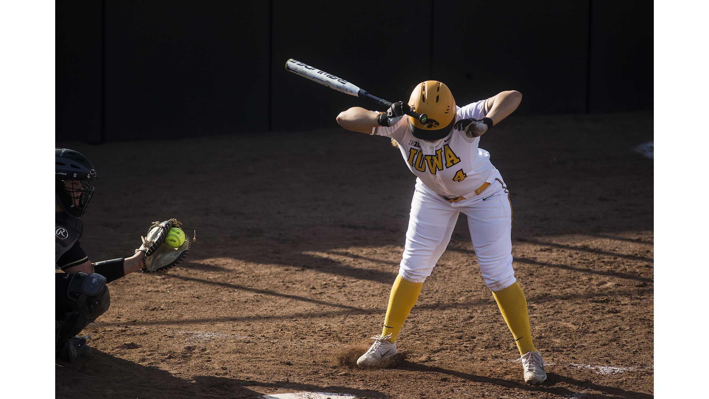Iowa's Taylor Libby dodges a pitch on the inside during the NCAA women's softball game between Iowa and Purdue at Bob Pearl Softball Field on Friday, May 4, 2018. The Hawkeyes lost to the Boilermakers 1-3. (Ben Allan Smith/The Daily Iowan)