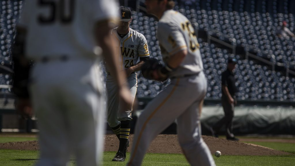 Iowa%27s+Nick+Allgeyer+returns+to+the+dugout+during+Iowa%27s+Big+Ten+tournament+Game+against+Michigan+at+TD+Ameritrade+Park+in+Omaha%2C+Neb.+on+Wed.+May+23%2C+2018.+The+Wolverines+defeated+the+Hawkeyes+2-1+in+extra+innings.+%28Nick+Rohlman%2FThe+Daily+Iowan%29