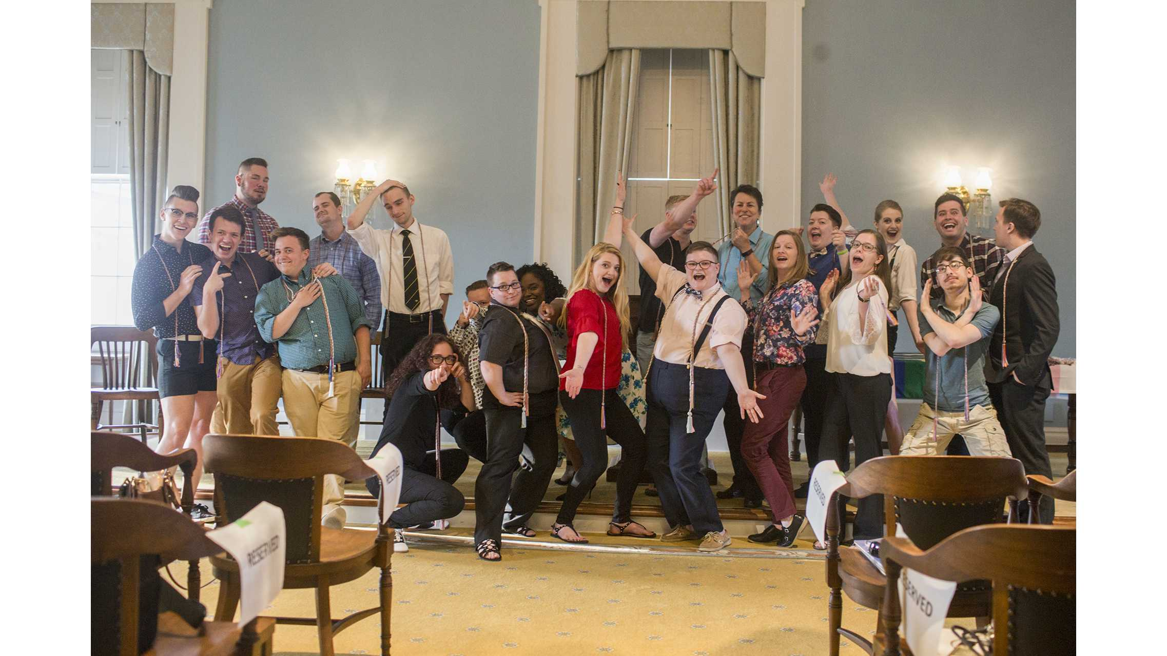 All graduating seniors that participated in the Rainbow Graduation pose after the event on Tue. May 8, 2018 held in the Old Capitol Senate Chamber. The Rainbow Graduation allows LGBTQ students to celebrate their graduation as a group. (Katie Goodale/The Daily Iowan)