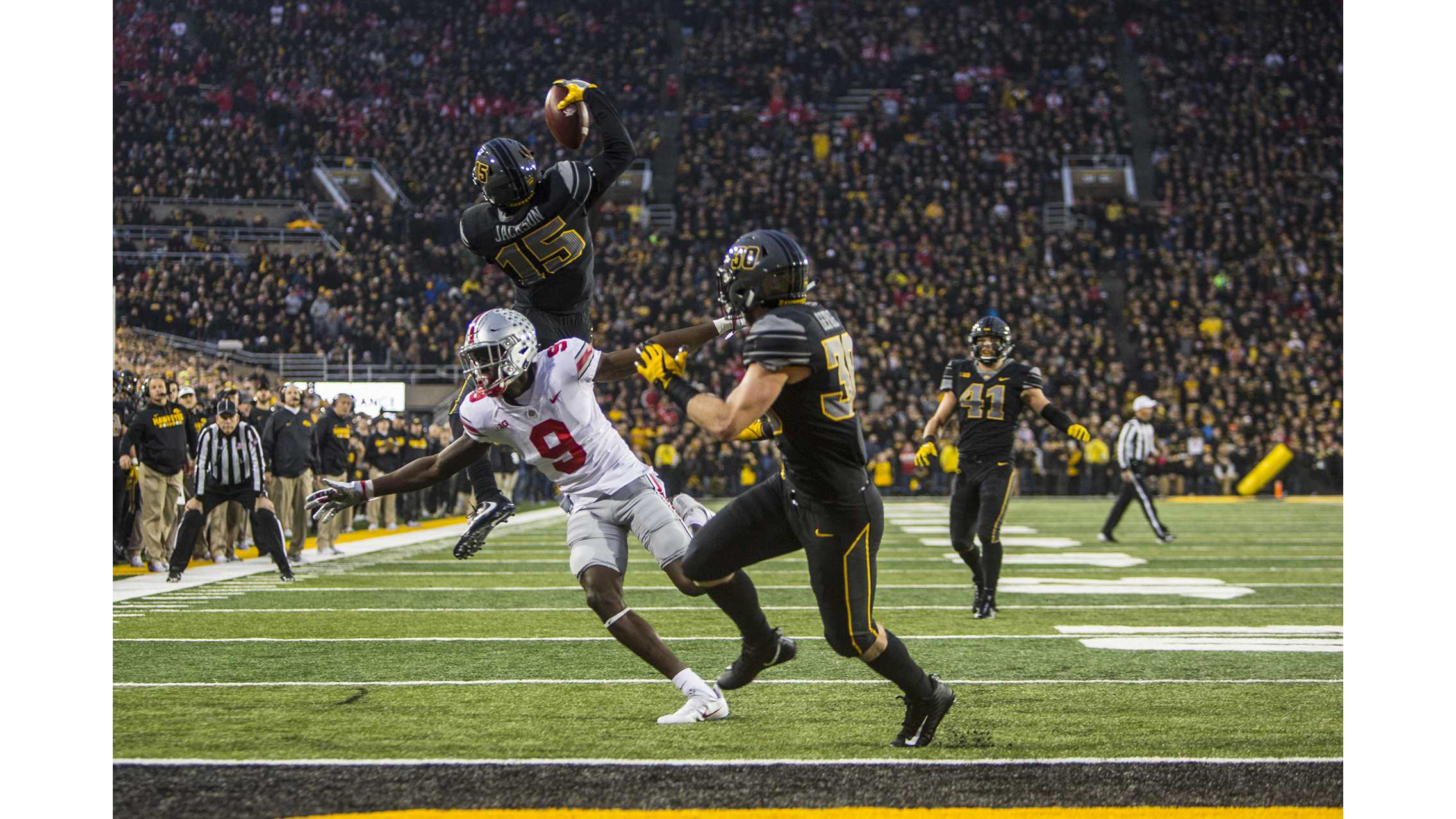 Iowa Cornerback Josh Jackson makes a jumping one handed interception during Iowa's game against Ohio State at Kinnick Stadium on Saturday, Nov. 4, 2017. Jackson made three interceptions on the day as the Hawkeyes defeated the Buckeyes 55 to 24. (Nick Rohlman/The Daily Iowan)