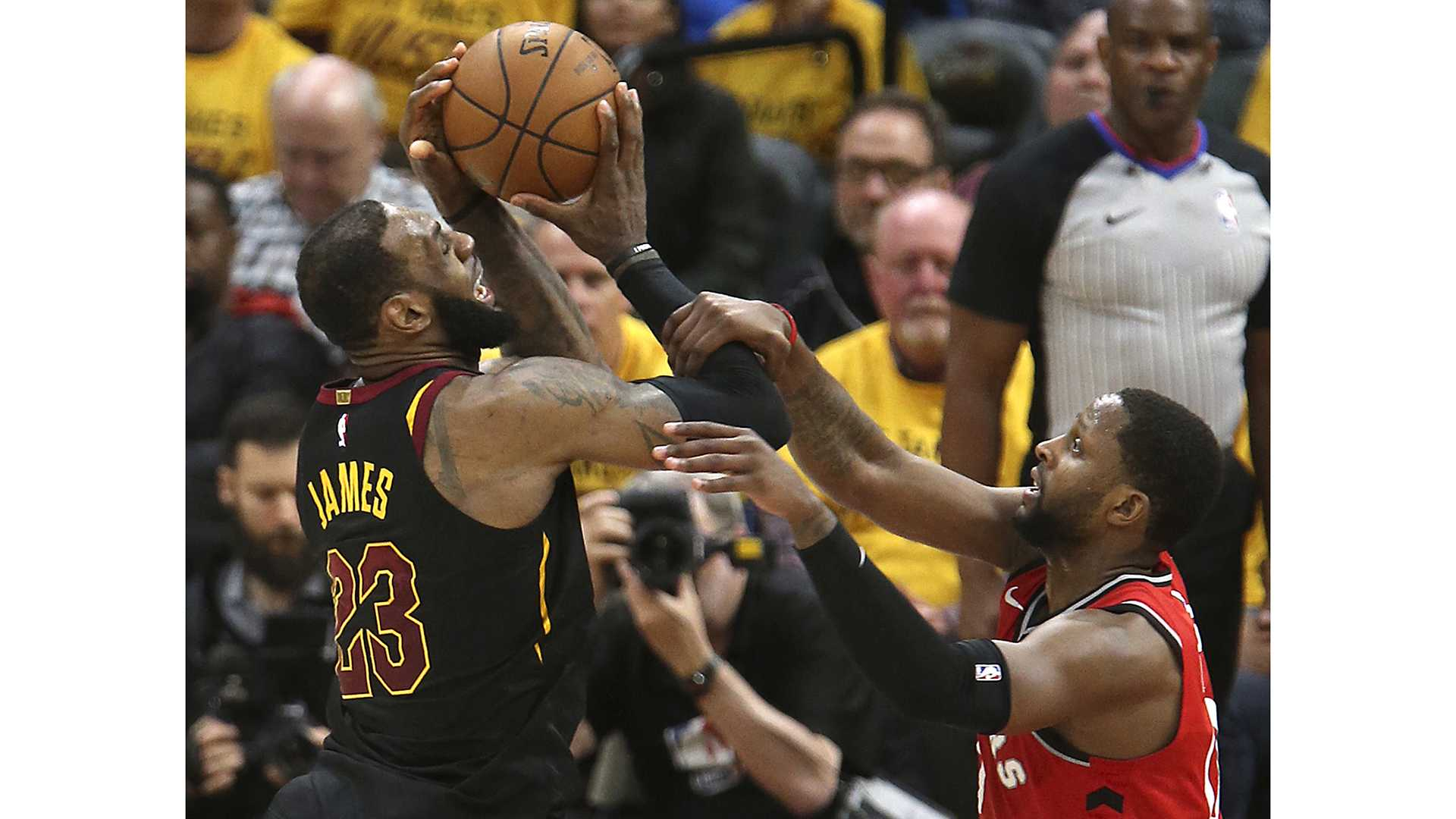 LeBron James is fouled by C.J. Miles in the third quarter of Game 4 of a second-round playoff series on Monday, May 7, 2018 in Cleveland, Ohio. The Cavaliers won the game 128-93 to sweep the series against the Raptors. (Phil Masturzo/Akron Beacon Journal/TNS)