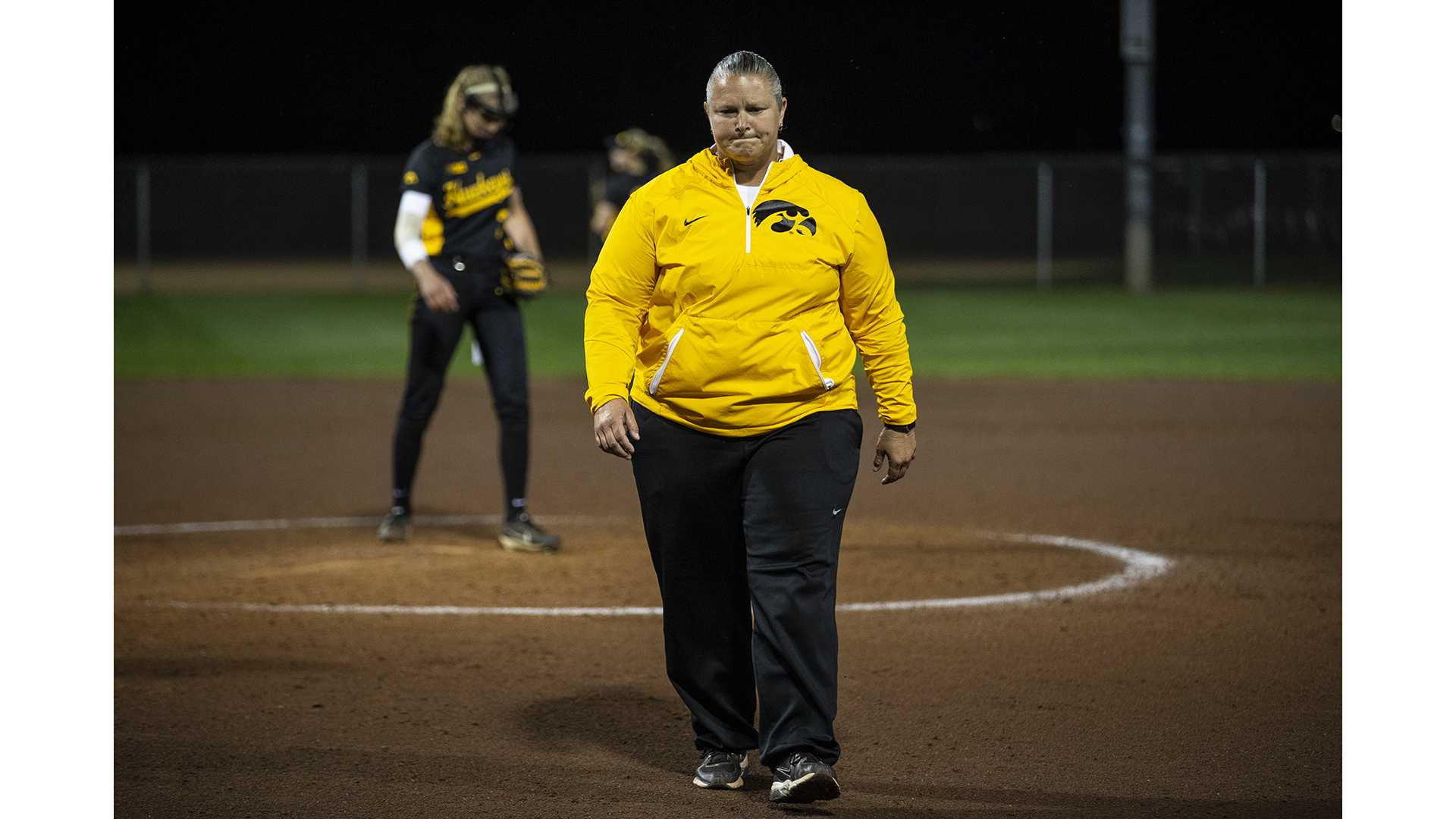 Iowa Head Coach Marla Looper walks off the field during Iowa's Big Ten tournament game against Ohio State at the Goodman Softball complex in Madison, WI. The Hawkeyes defeated the Buckeyes 5-1. (Nick Rohlman/The Daily Iowan)